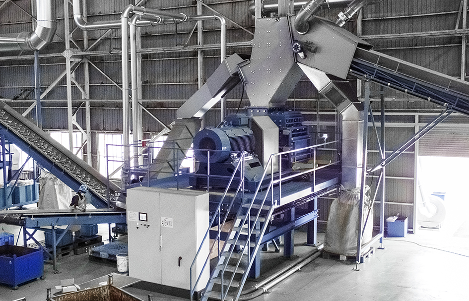 Electronic waste recycling. Eldan Ring Shredder used in WEEE recycling. Waste Electrical and Electronic Equipment